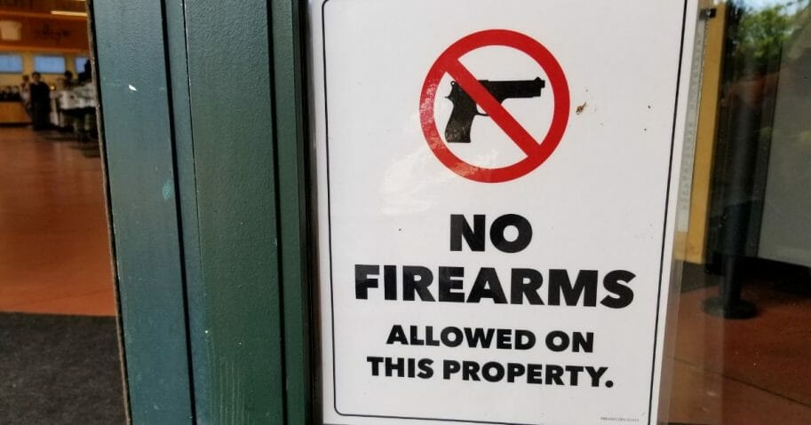 "Sign with text reading ""No Firearms Allowed on this Property."""