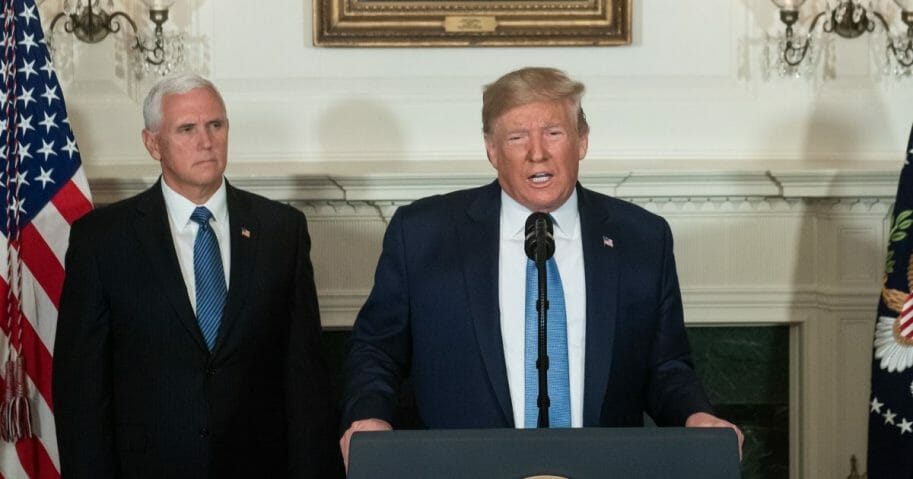 President Donald Trump speaks alongside Vice President Mike Pence about the mass shootings from the Diplomatic Reception Room of the White House in Washington, DC, August 5, 2019.