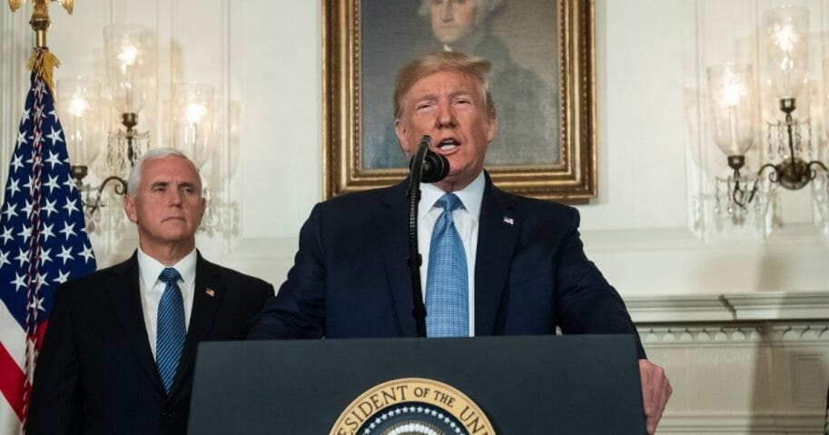President Donald Trump speaks alongside Vice President Mike Pence about the mass shootings from the Diplomatic Reception Room of the White House in Washington, D.C., Aug. 5, 2019.
