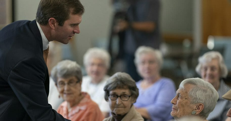 In this Thursday, Sept. 27, 2019, file photo, Kentucky Attorney General and Democratic gubernatorial candidate Andy Beshear greets residents at Sayre Christina Village Senior Living Center in Lexington, Ky