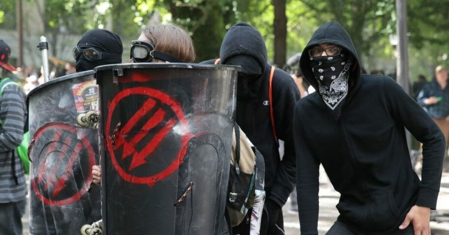 Police clash with demonstrators as they try to clear 'Antifa' members and anti-Trump protesters from the area during a protest on June 4, 2017, in Portland, Oregon.