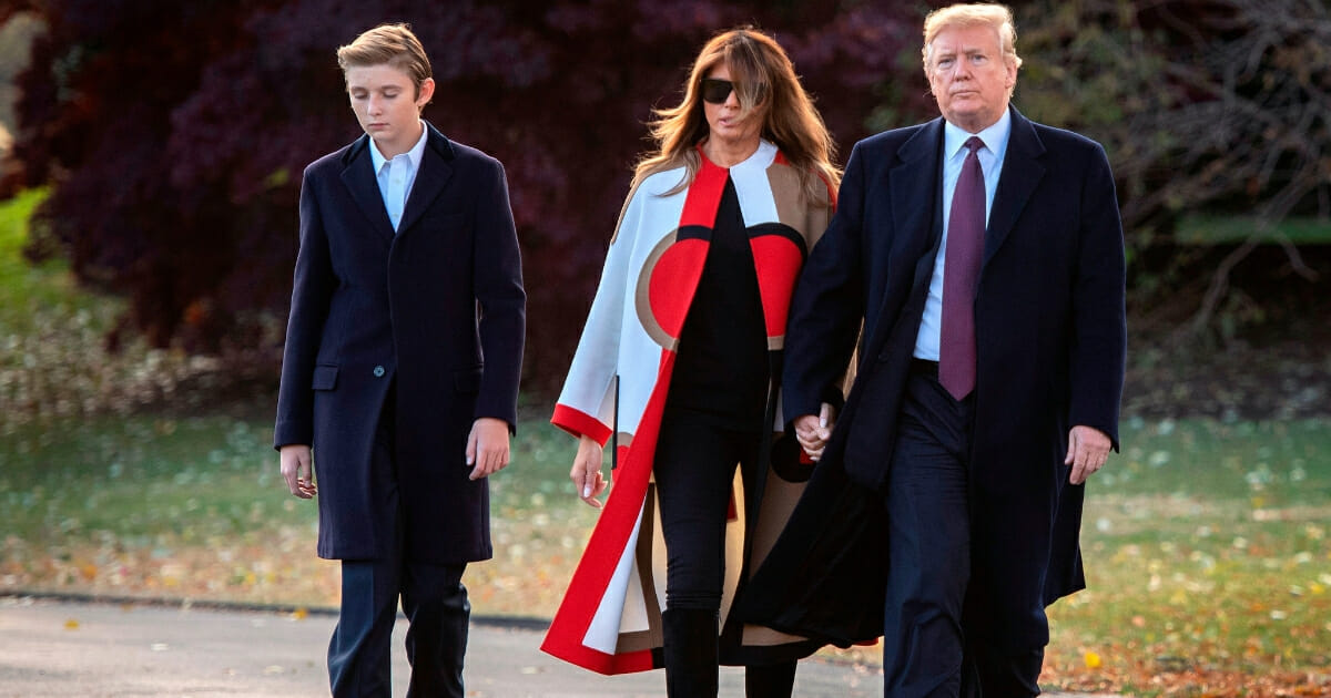President Donald Trump, right, first lady Melania Trump and their son Barron depart the White House in Washington, D.C., on Nov. 20, 2018.