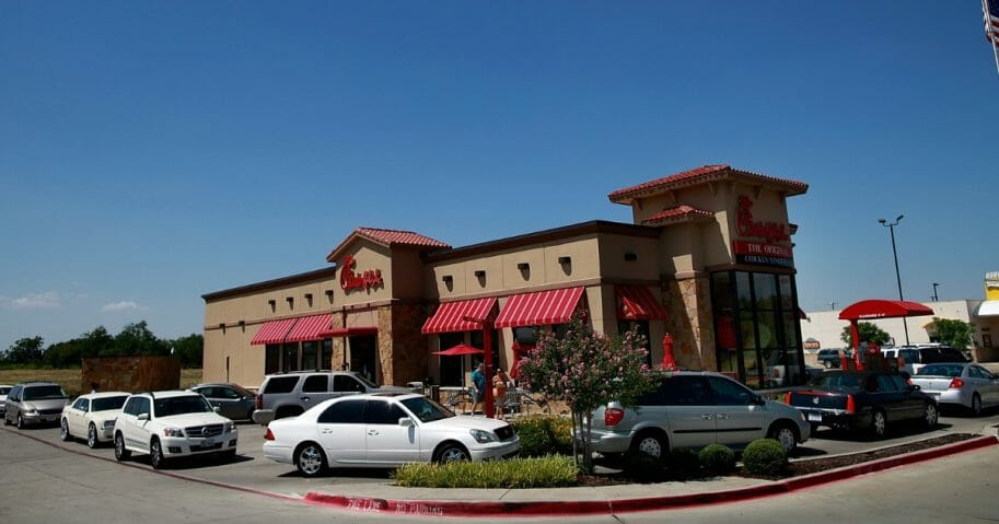 Drive-through customers wait in line at a Chick-fil-A restaurant on Aug. 1, 2012, in Fort Worth, Texas.