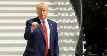 President Donald Trump gestures as he returns to the White House after attending the United Nations General Assembly on Sept. 26, 2019, in Washington, D.C.
