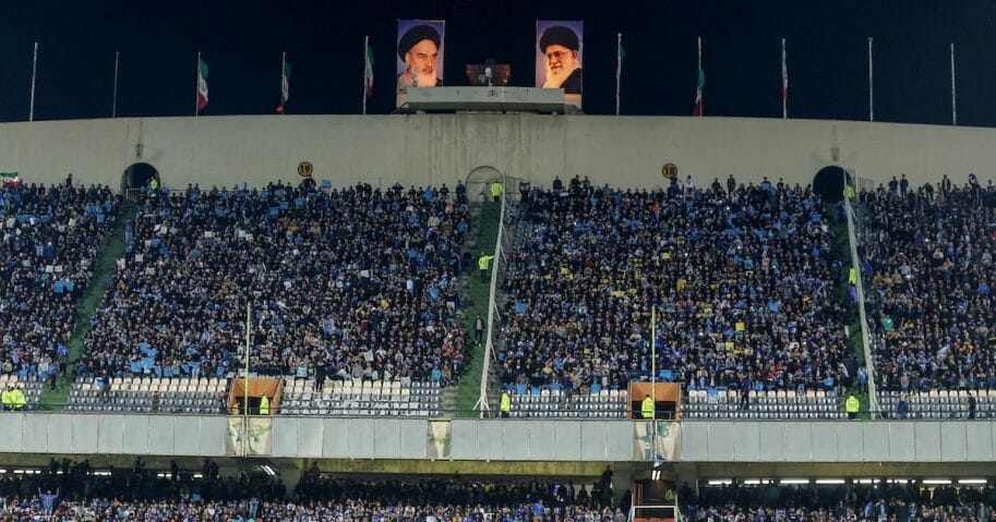 Esteghlal's fans cheer for their team during the AFC champions league Group C football match between Iran's Esteghlal and UAE's Al Ain at the Azadi stadium in the Iranian capital Tehran on March 12, 2019.