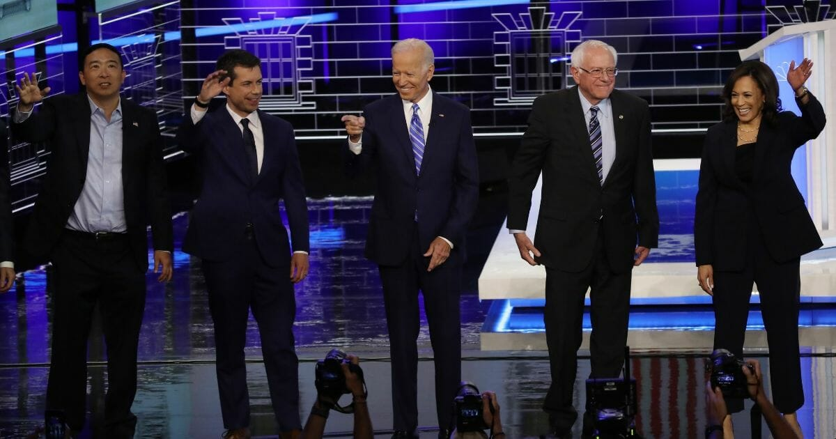 Democratic presidential candidates former tech executive Andrew Yang, South Bend, Indiana Mayor Pete Buttigieg, former Vice President Joe Biden, Sen. Bernie Sanders (I-VT) and Sen. Kamala Harris (D-CA) take the stage for the second night of the first Democratic presidential debate on June 27, 2019, in Miami, Florida.
