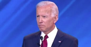 Progressive activists silenced a sad-faced Joe Biden on Thursday night as they erupted in protests while the former vice president prepared to answer the final question at the Democratic presidential debate.