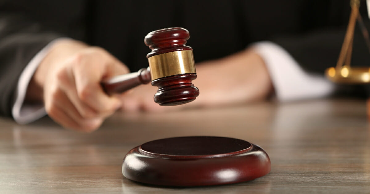 A judge hitting a gavel.
