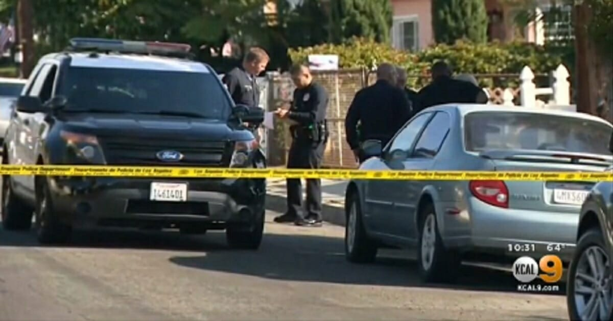 Police on the scene of a shooting where a Los Angeles homeowner killed a home intruder on Thursday.