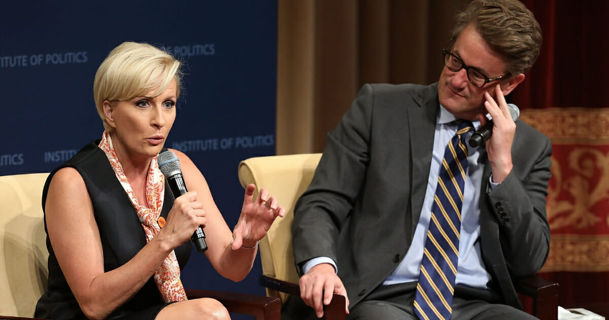 """MSNBC """"Morning Joe"""" hosts Joe Scarborough, right, and Mika Brzezinski are interviewed by philanthropist and financier David Rubenstein during a Harvard Kennedy School Institute of Politics event in the McGowan Theater at the National Archives on July 12, 2017, in Washington, D.C."""