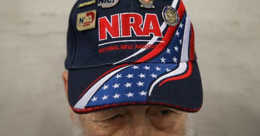 Gaylen Searles of Alaska wears an NRA hat during the organization's 2018 convention in Dallas.