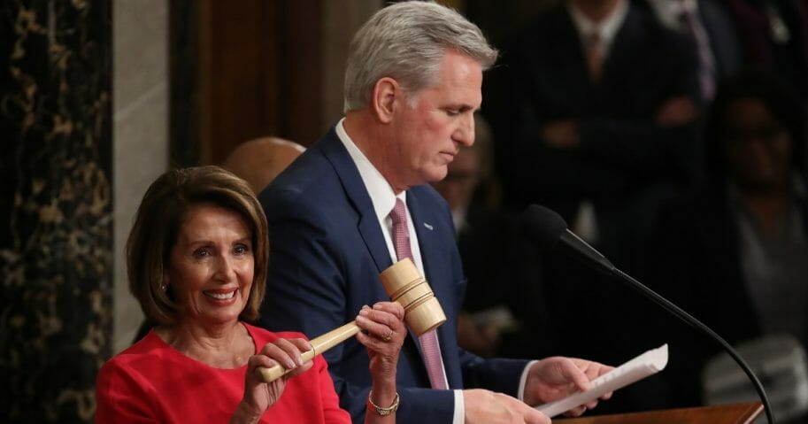 Democratic Rep. Nancy Pelosi smiles after receiving the House speaker's gavel from fellow Californian Kevin McCarthy.