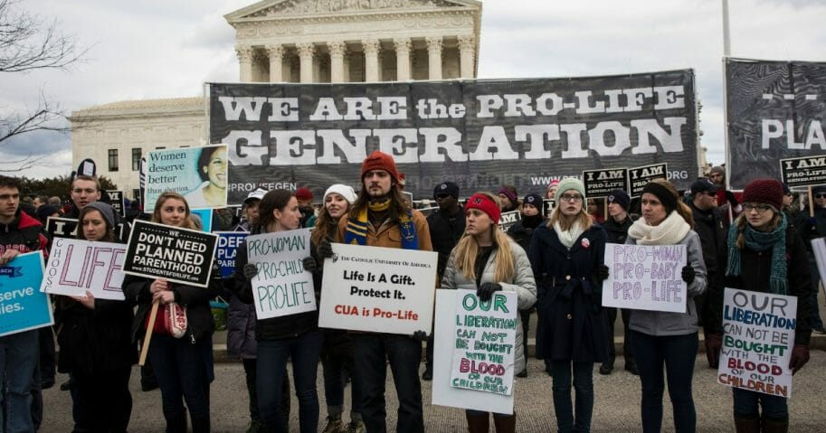 Pro-life demonstrators protest in front of the Supreme Court during the 44th annual March for Life in Washington, D.C., on Jan. 27, 2017.