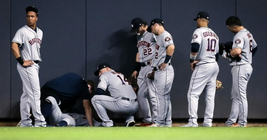George Springer of the Houston Astros is attended to after hitting the wall in the fifth inning against the Milwaukee Brewers.