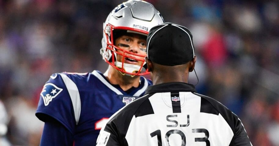 New England Patriots quarterback Tom Brady has a word with side judge Eugene Hall during a preseason game against the Carolina Panthers at Gillette Stadium.
