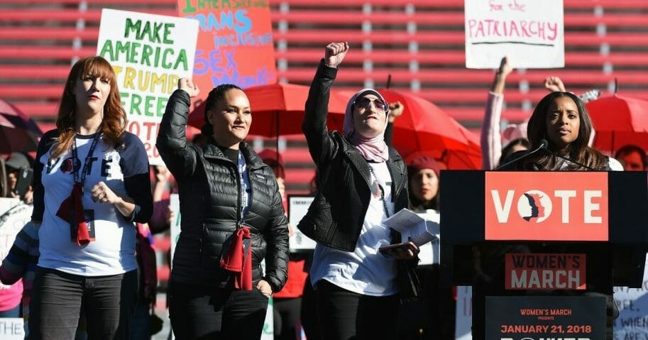"Women's March Co-Chairwomen Bob Bland, Carmen Perez, Linda Sarsour and Tamika D. Mallory speak during the Women's March ""Power to the Polls"" voter registration tour launch at Sam Boyd Stadium on Jan. 21, 2018, in Las Vegas, Nevada."