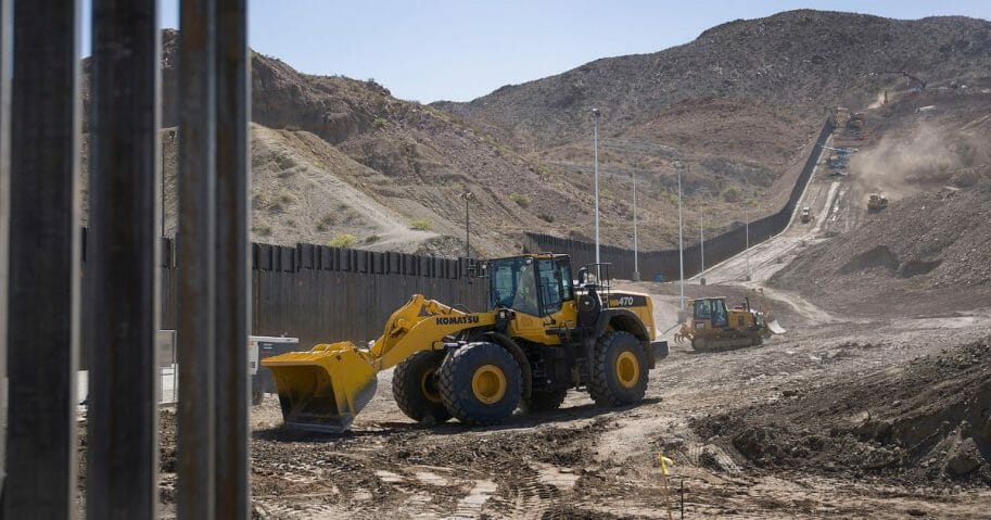 Construction crews work on a border wall being put in place by We Build The Wall Inc. on June 01, 2019 in Sunland Park, New Mexico.