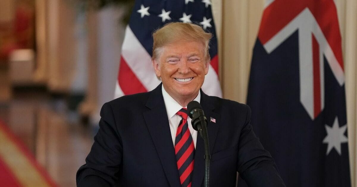 President Donald Trump smiles during a press conference with Australian Prime Minister Scott Morrison in the East Room of the White House in Washington, D.C., on Sept. 20, 2019.