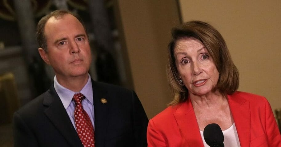 House Minority Leader Nancy Pelosi speaks at a news conference with Rep. Adam Schiff.