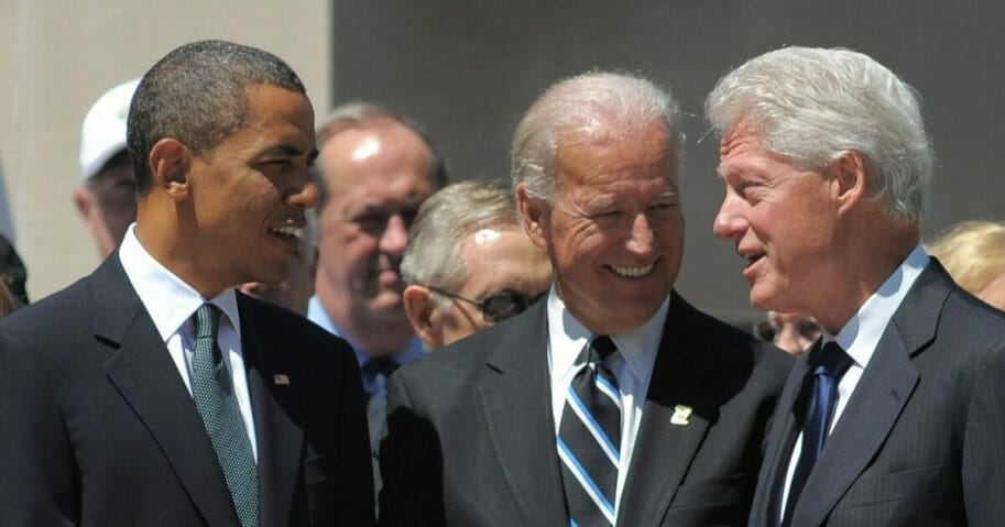 Then-President Barack Obama, then-Vice President Joe Biden and former President Bill Clinton chat before the start of a memorial service for Senator Robert Byrd on July 2, 2010, at the West Virginia State Capitol in Charleston, West Virginia.