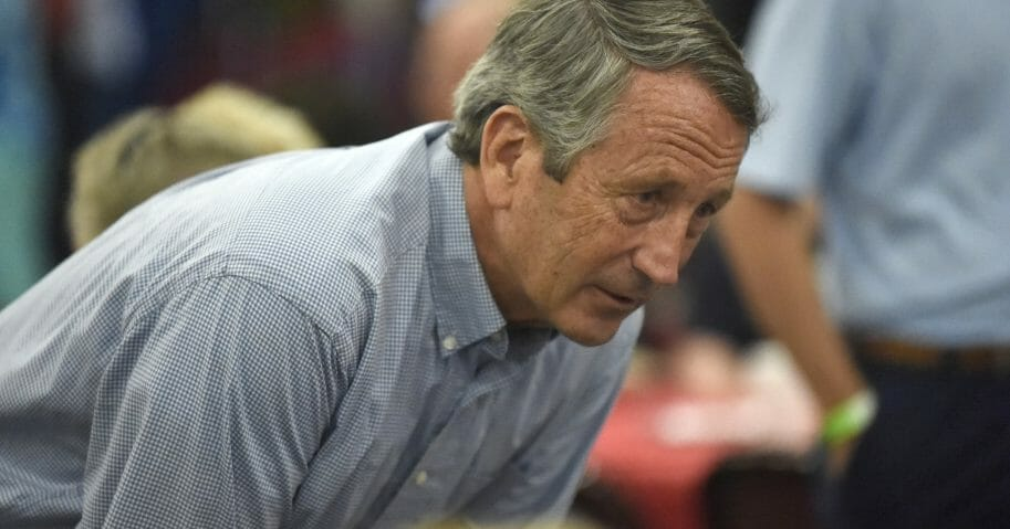 In this Aug. 26, 2019, file photo, former Rep. Mark Sanford speaks with attendees at Rep. Jeff Duncan's annual fundraiser in Anderson, S.C.