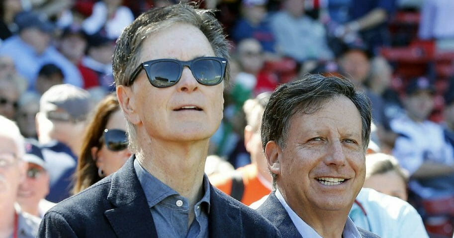 In this Sept. 27, 2015, file photo, Boston Red Sox owners John Henry, left, and Tom Werner look on before a baseball game between the Red Sox and the Baltimore Orioles in Boston.