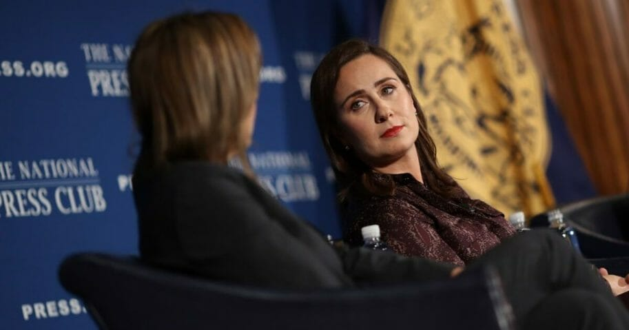 """Robin Pogrebin (L) and Kate Kelly (C), authors of the book """"The Education of Brett Kavanaugh"""", answer questions about the on book Sept. 18, 2019 in Washington, D.C."""