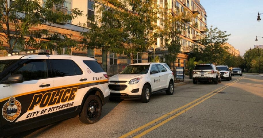 """PIttbusrgh emergency vehicles line the street oustide apartments where the victims of a mysterious """"medical situation"""" were found early Sunday morning."""