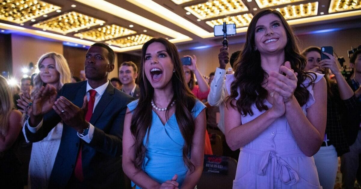 Supporters of US President Donald Trump cheer as he appears on stage before addressing the Turning Point USAs Teen Student Action Summit in Washington, DC, on July 23, 2019.