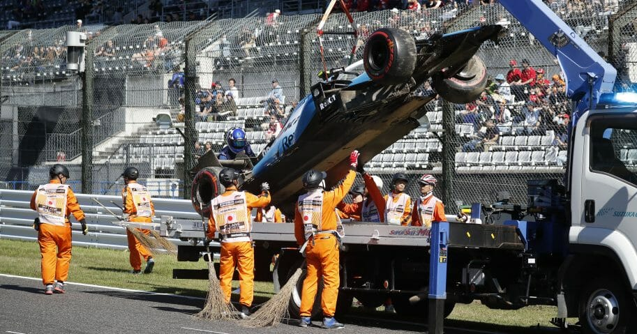 The car of Williams driver Robert Kubica of Poland is removed from the track after crashing during the qualifying session for the Japanese Formula One Grand Prix at Suzuka Circuit in Suzuka, central Japan, Sunday, Oct. 13, 2019.