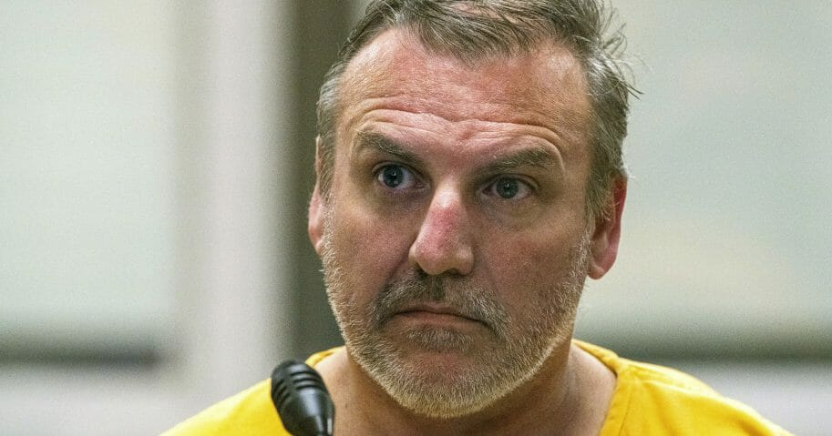 Brian Steven Smith attends his arraignment on a charge of first-degree murder in Anchorage, Alaska.