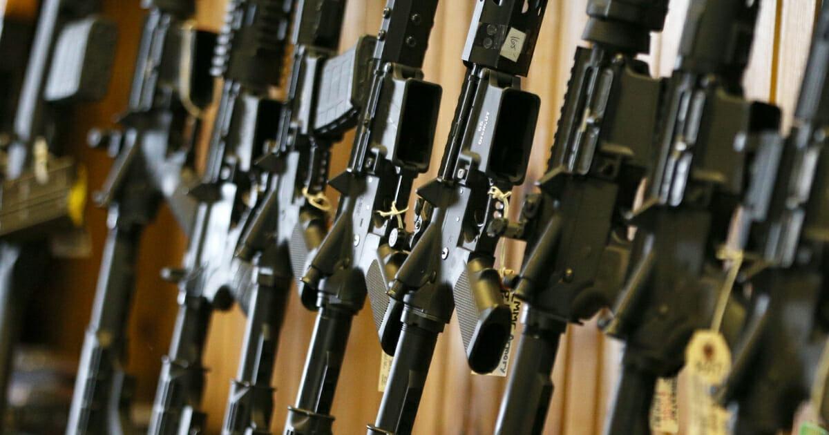 Semiautomatic AR-15 rifles are displayed for sale at Good Guys Guns & Range in Orem, Utah, on Feb.15, 2018.
