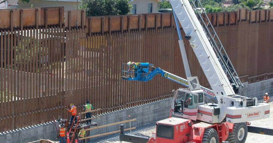 Crews work on a stretch of new border wall in San Ysidro, California.