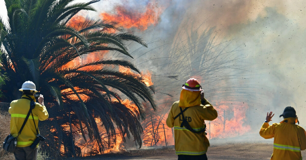 Fire erupts near a ranch on Tierra Rejada Road near the Ronald Reagan Presidential Library in Simi Valley, California.