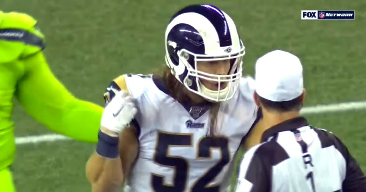 Clay Matthews of the Los Angeles Rams complains to an official about a roughing call.