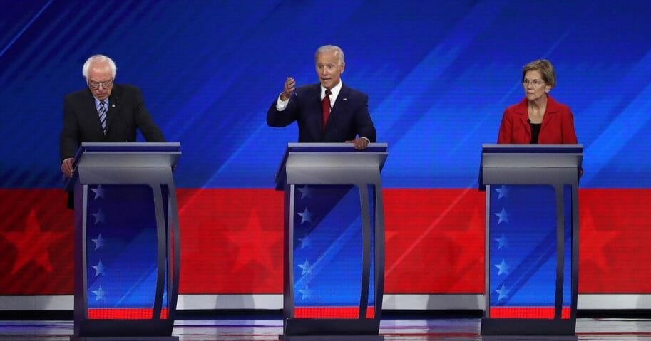 Democratic presidential candidates Sen. Bernie Sanders (I-VT), former Vice President Joe Biden, and Sen. Elizabeth Warren (D-MA) on stage during the Democratic Presidential Debate at Texas Southern University's Health and PE Center on Sept. 12, 2019, in Houston, Texas.