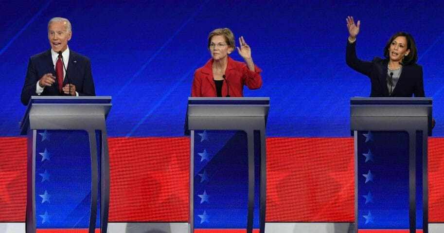 Former Vice President Joe Biden, Massachusetts Sen. Elizabeth Warren and California Sen. Kamala Harris gesture during the third Democratic primary debate of the 2020 presidential campaign at Texas Southern University in Houston.