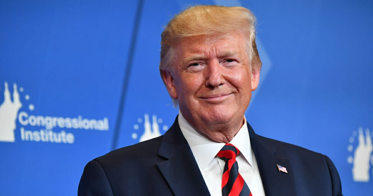 President Donald Trump smiles as he delivers remarks during the 2019 House Republican Conference Member Retreat Dinner in Baltimore, Maryland, on Sept. 12, 2019.