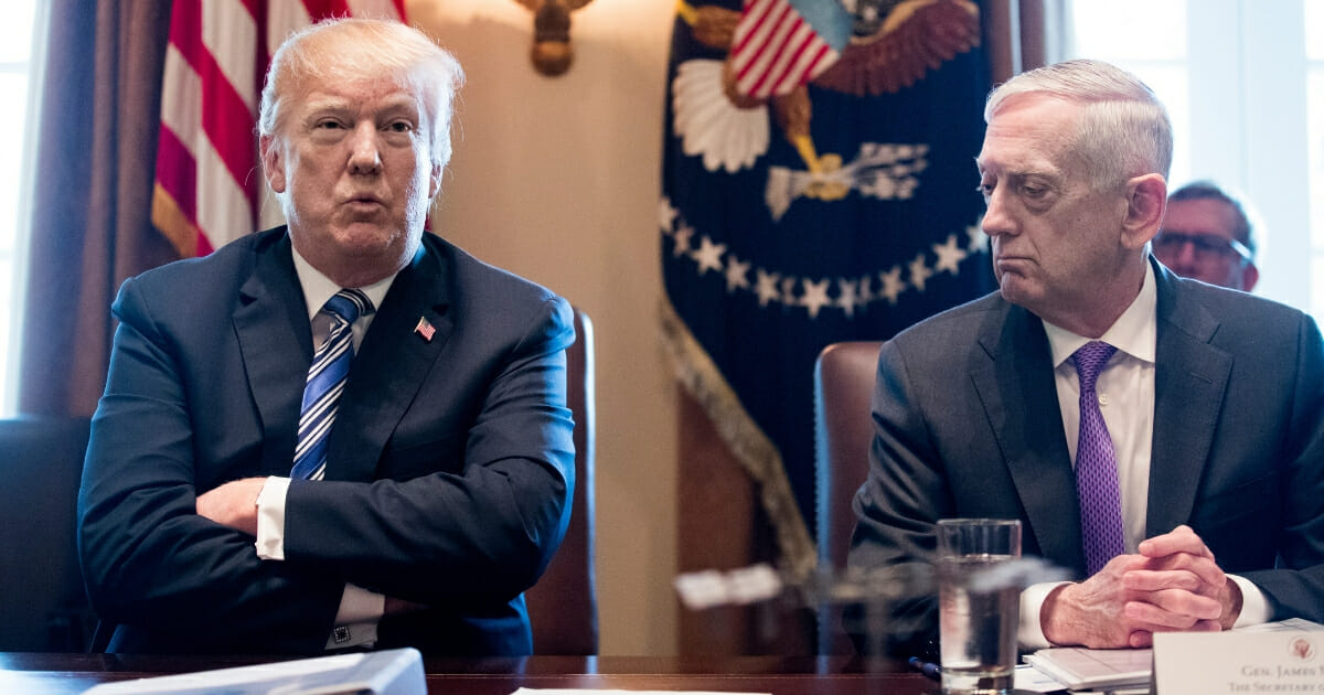 President Donald Trump, left, speaks beside then-Secretary of Defense Jim Mattis during a meeting with members of his Cabinet, in the Cabinet Room of the White House on March 8, 2018 ,in Washington, D.C.