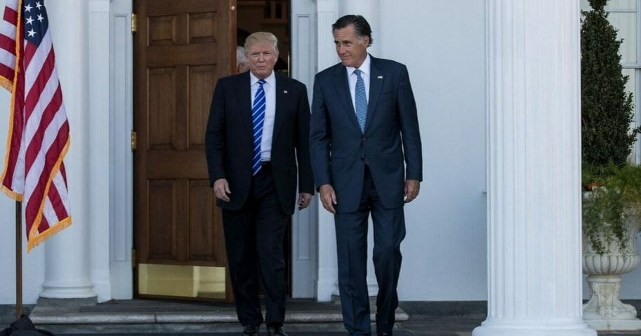 President-elect Donald Trump and Mitt Romney leave the clubhouse after their meeting at Trump International Golf Club, Nov. 19, 2016, in Bedminster Township, New Jersey.