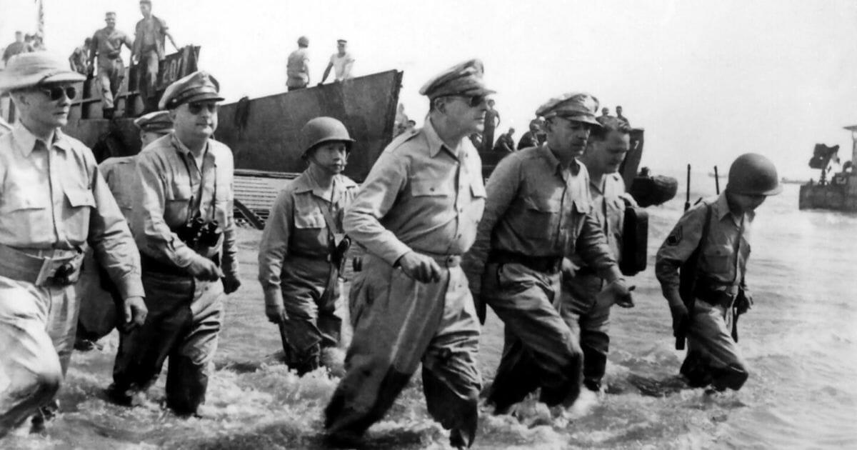 Gen. Douglas MacArthur wades ashore a Philippine beach on Oct. 20, 1944.