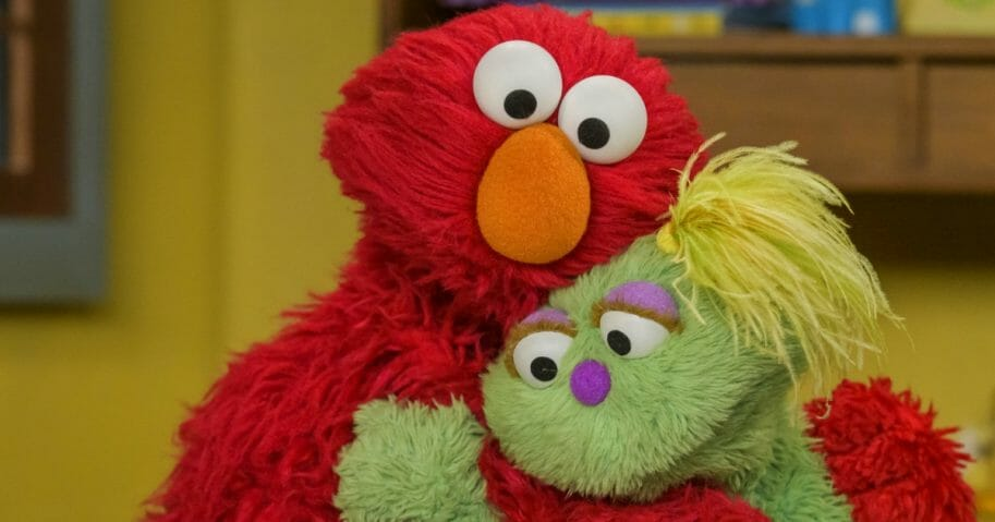 Elmo, left, comforts Karli, a relatively new Sesame Street character.