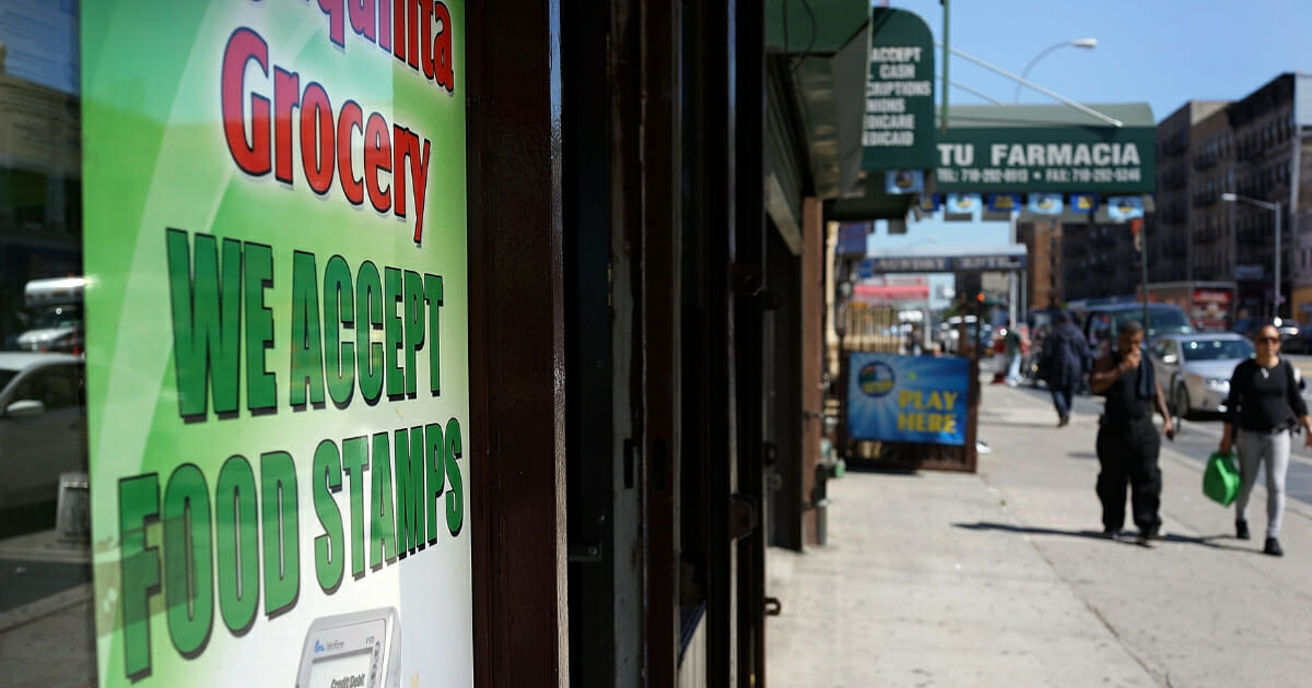 A grocery store in New York's South Bronx advertises that it accept food stamps.
