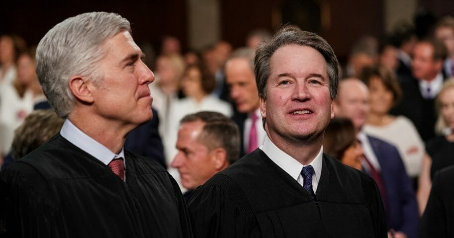 Supreme Court Justices Neil Gorsuch, left, and Brett Kavanaugh attend the State of the Union address at the Capitol.