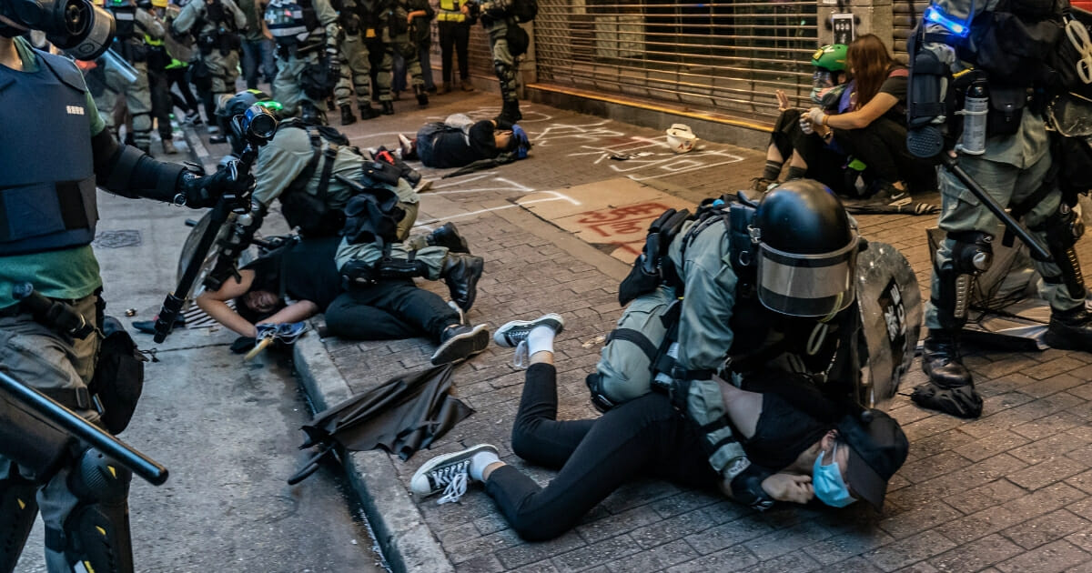 Pro-democracy protesters are arrested by police during a demonstration in Hong Kong's Wan Chai district on Oct. 6, 2019.