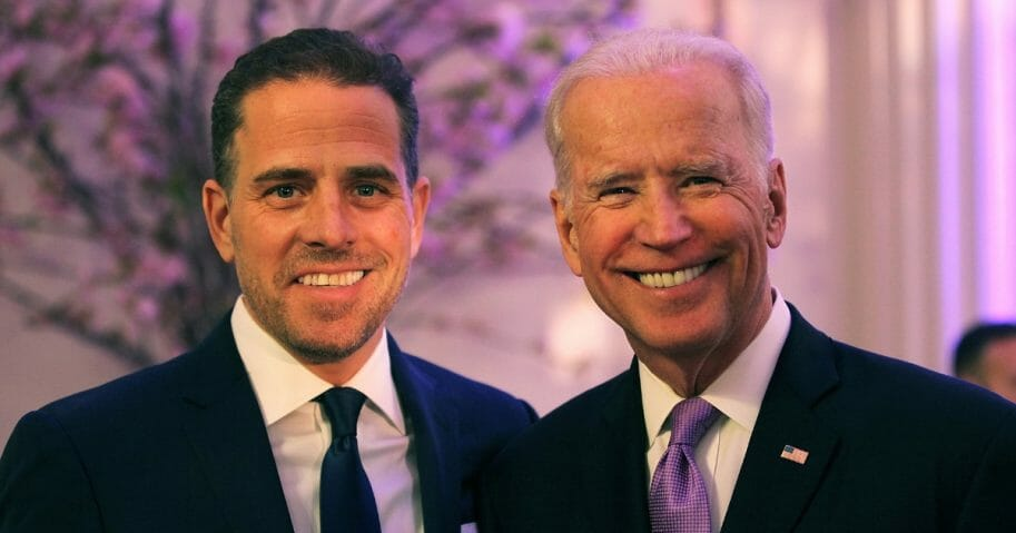 Then-Vice President Joe Biden and his son, Hunter, attend the World Food Program USA's Annual McGovern-Dole Leadership Award Ceremony at the Organization of American States on April 12, 2016, in Washington, D.C.