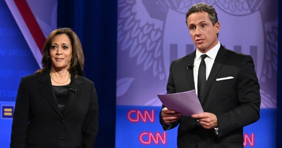 Democratic presidential hopeful and California Sen. Kamala Harris speaks on stage alongside CNN moderator Chris Cuomo during a town hall devoted to LGBT issues.