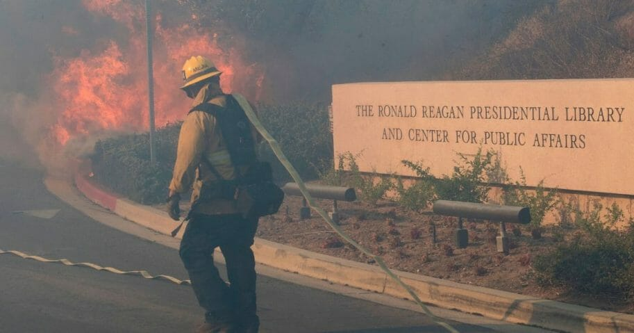 Firefighters battle to protect the Ronald Reagan Presidential Library from the Easy Fire in Simi Valley, California, on Oct. 30, 2019.