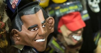 A mask of then-President Barack Obama sits with other Halloween masks on a wall at Spirit Halloween costume store in Easton, Maryland, on Oct. 21, 2013.