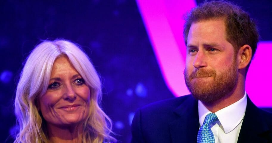 Prince Harry, Duke of Sussex reacts next to television presenter Gaby Roslin as he delivers a speech during the WellChild Awards at Royal Lancaster Hotel on Oct. 15, 2019, in London, England.